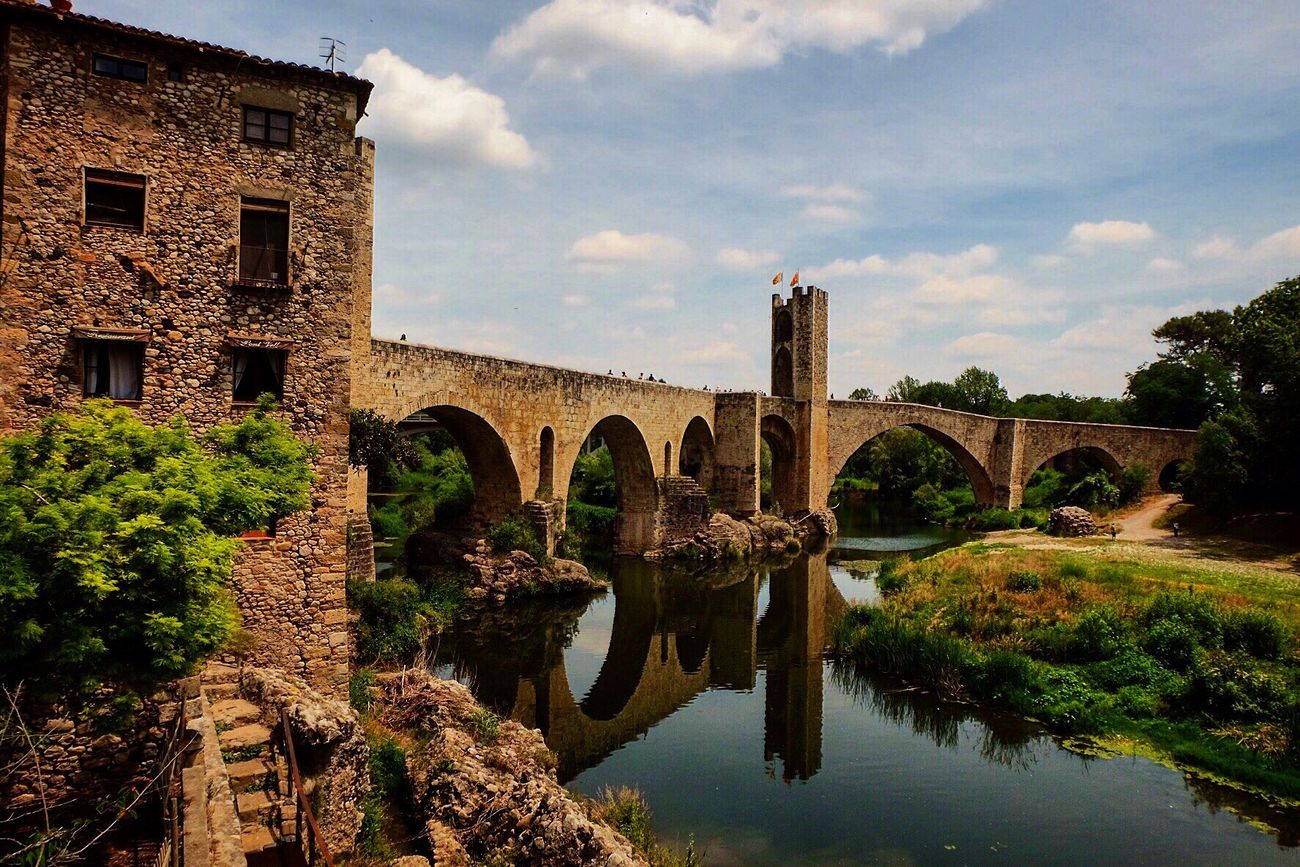 Bridge - Man Made Structure Arch Bridge Architecture Arch Built Structure Connection Sky Water Cloud - Sky River Day Outdoors No People Tree Nature Vacations Fujifilm Catalonia SPAIN
