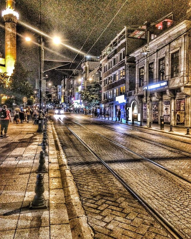 Building Exterior Architecture City Built Structure Illuminated Street Tramway Street Light Transportation Night Road City Life City Street Railroad Track Incidental People Mode Of Transport Travel Destinations Power Line  Outdoors Cable Car
