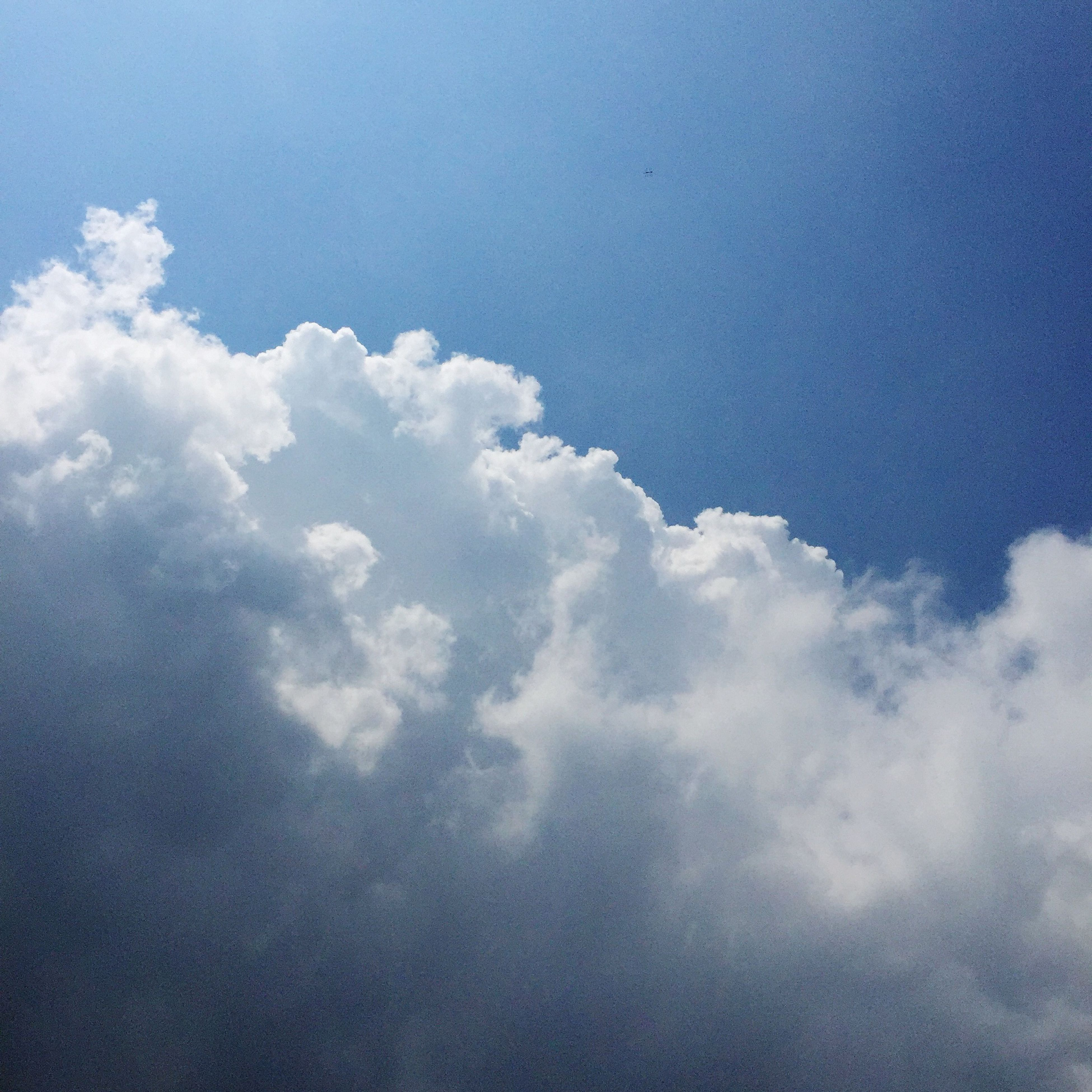 sky, low angle view, cloud - sky, blue, beauty in nature, tranquility, sky only, scenics, nature, tranquil scene, cloud, cloudy, cloudscape, backgrounds, idyllic, outdoors, day, white color, no people, majestic