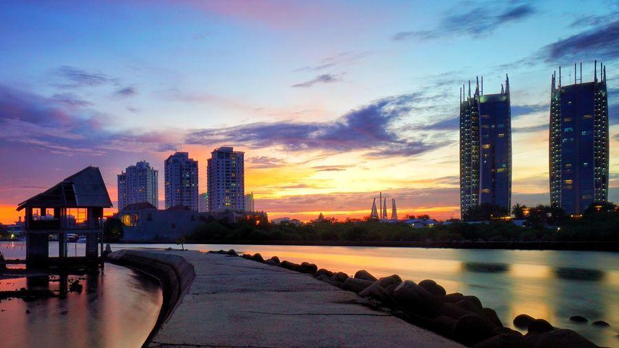 sunset at Regatta Jakarta. Photography By @jgawibowo Arif Wibowo Photoworks Shot By @jgawibowo Shot By Arif Wibowo Urban Skyline Reflection Skyscraper Architecture Night Sunset Cityscape Bridge - Man Made Structure Illuminated Water
