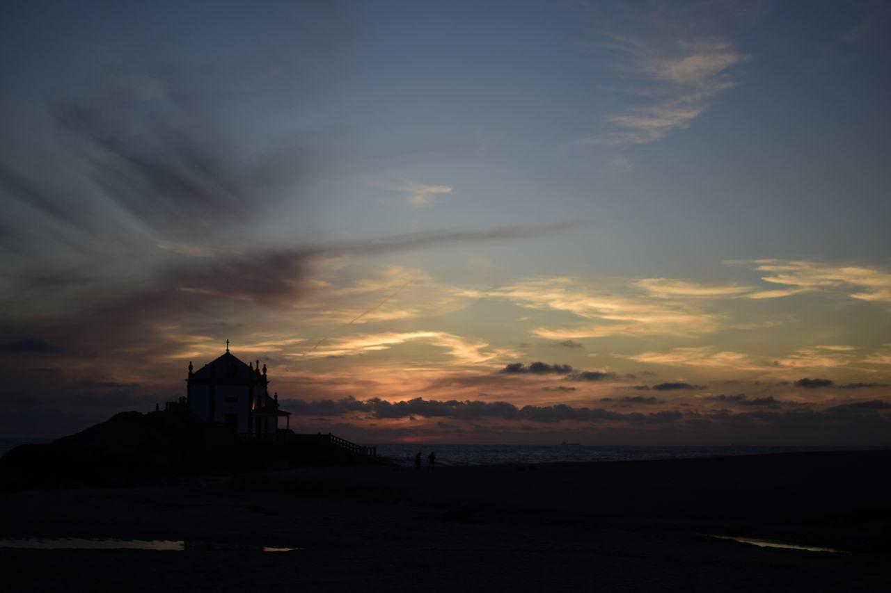 Capela Do Senhor Da Pedra At Silhouette Beach During Sunset