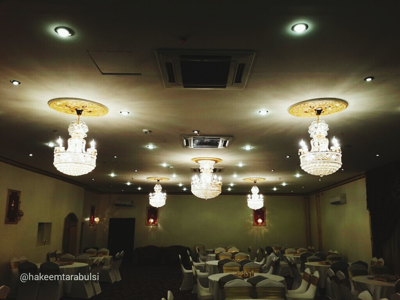 lighting equipment, illuminated, indoors, in a row, ceiling, luxury, no people, hanging, architecture, day