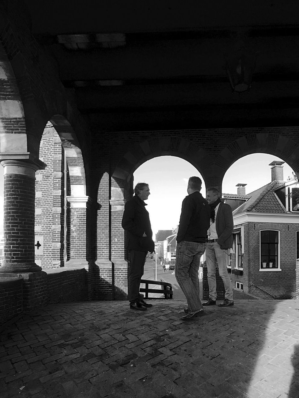 Real People Lifestyles Full Length Architectural Column Standing Arch Built Structure Day Architecture Men Outdoors People Men Talking Netherlands IPhoneography Light And Shadow Traditional Architecture Architecture Black & White Black And White