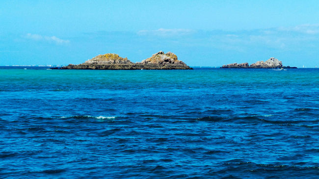 Sea Blue Waterfront Seascape Beauty In Nature Island Horizon Over Water Nature Shallow Rock Formation Coastal Feature Tranquility Tranquil Scene Water Surface Clear Sky Coastline Rock - Object Idyllic Rocks In Water Blue Water Rocks Travel Destinations Île De Houat Bretagne France