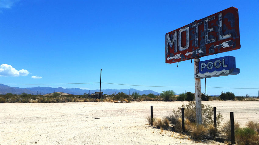 Abandoned motel sign along Route 66 in California. Abandoned Arrow Symbol Blue Copy Space Desert Disrepair Empty Falling Apart Landscape Motel Motel Sign Neon Neon Sign Route 66 Seen Better Days Sign Sky Urban Exploration Kiomi Collection My Favorite Photo The Great Outdoors With Adobe