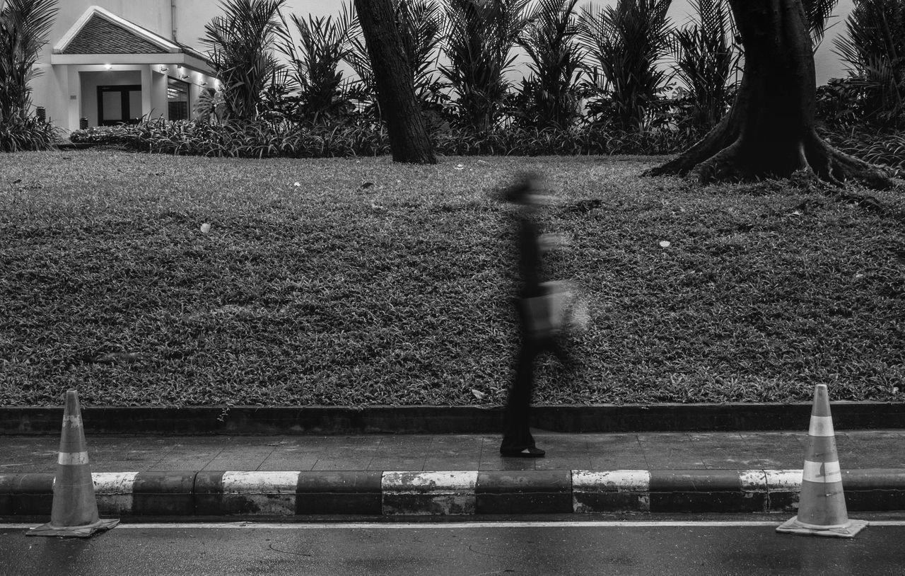 Contrast in Motion Blackandwhite Blurred Motion Everyday Life Motion Motion Blur Moving Street Walking The Street Photographer - 2017 EyeEm Awards