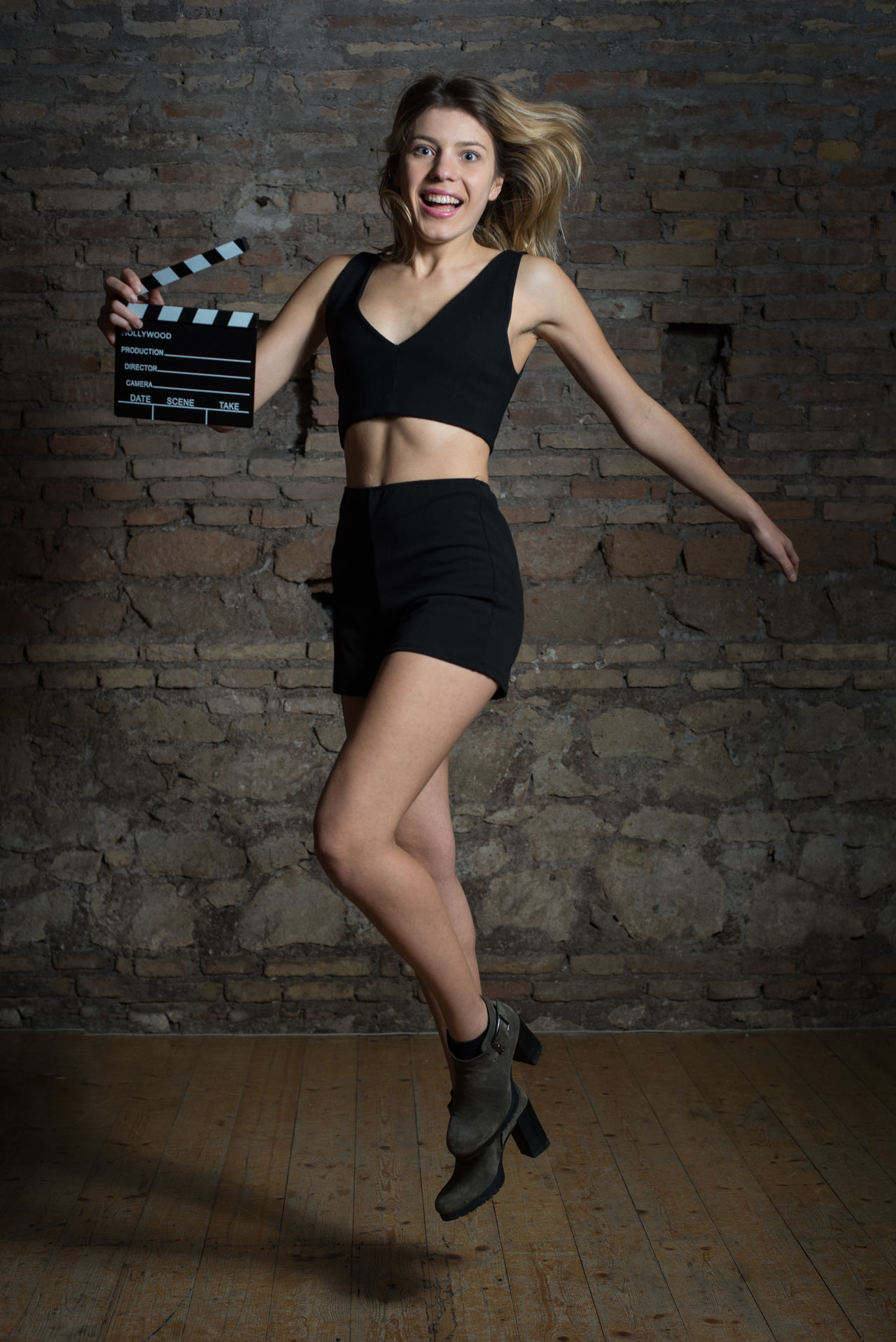 Young blonde actress with movie clapper board Actress Audition Beautiful Blond Hair Blonde Cinema Clapboard Clapper Clapperboard Film Girl Happy Jumping Looking At Camera MOVIE Pretty Smiling Woman Young