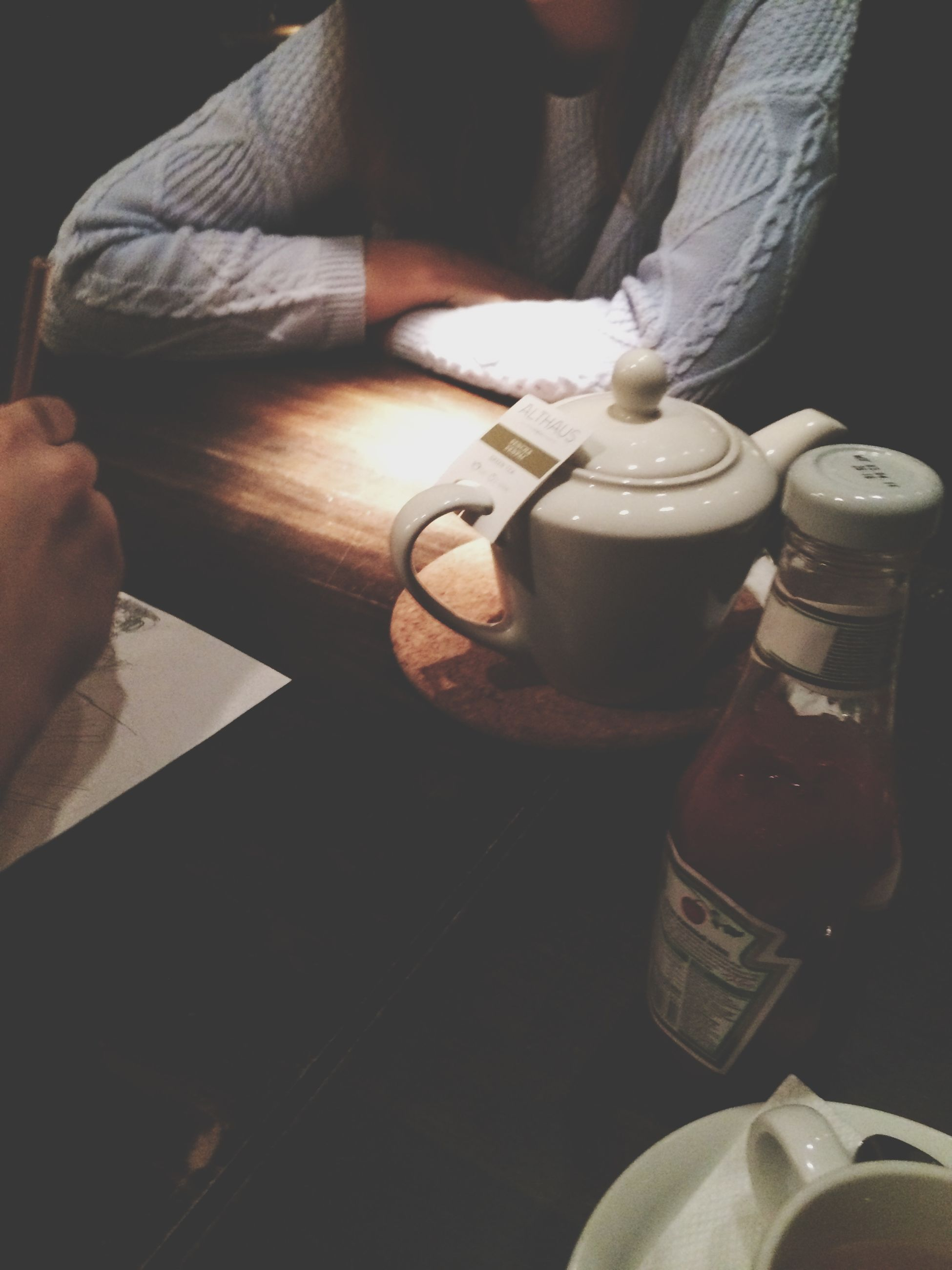 indoors, person, holding, part of, food and drink, men, lifestyles, table, cropped, unrecognizable person, coffee cup, drink, close-up, high angle view, leisure activity