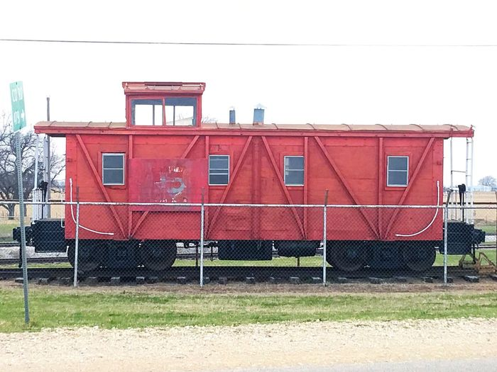 Red Caboose Caboose Train Car Old Red Train No People IPhoneography IPhone Streetphotography Roadside America Street Photography Texas Transportation Red Stationary Still Life Road Art Street Minimalist Architecture Streetart Roadside Roadside Shots Vintage Cars Vintage Train