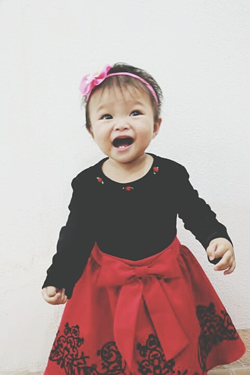 childhood, cute, one person, innocence, front view, baby, portrait, looking at camera, studio shot, babies only, real people, standing, indoors, smiling, day, close-up, people