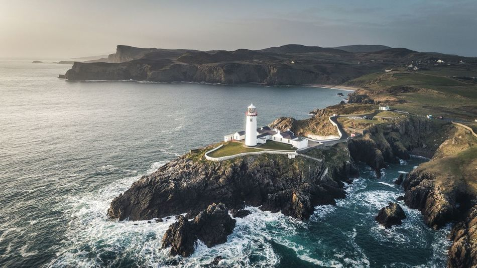 Above the Lighthouse Lighthouse Sea Building Exterior Guidance Rock - Object Coastline Cliff Travel Destinations Outdoors Nautical Vessel Architecture No People Day Nature