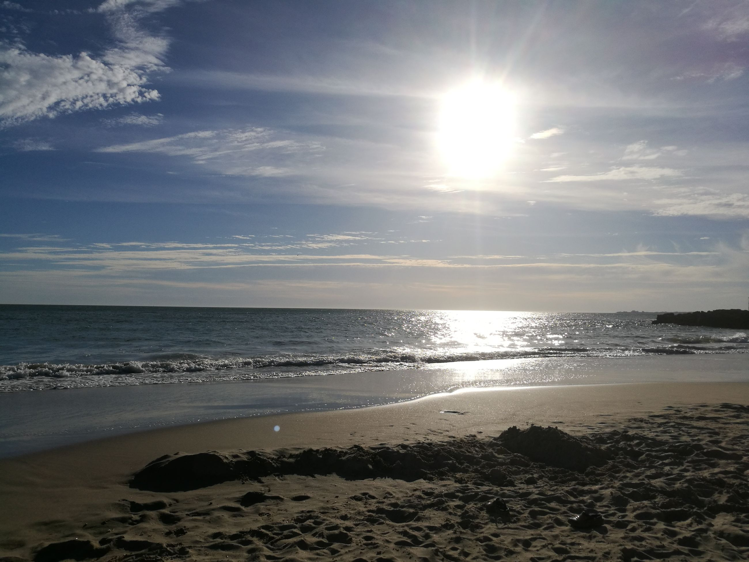 sea, beach, sunlight, sun, water, sand, horizon over water, scenics, nature, beauty in nature, sky, shore, sunbeam, tranquility, tranquil scene, sunset, no people, outdoors, wave, day