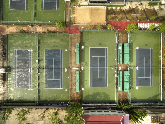Flying High Drone View Green Color Multi Colored View From Above Drone  Above The City High Angle View Urban Skyline Tennis 🎾 Tennis Club Tenniscourt Sport Competition Sport Complex Competition Match Championship