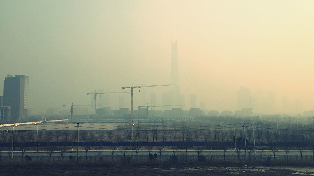 architecture, built structure, fog, building exterior, no people, outdoors, sky, city, factory, tall, day, nature, cityscape