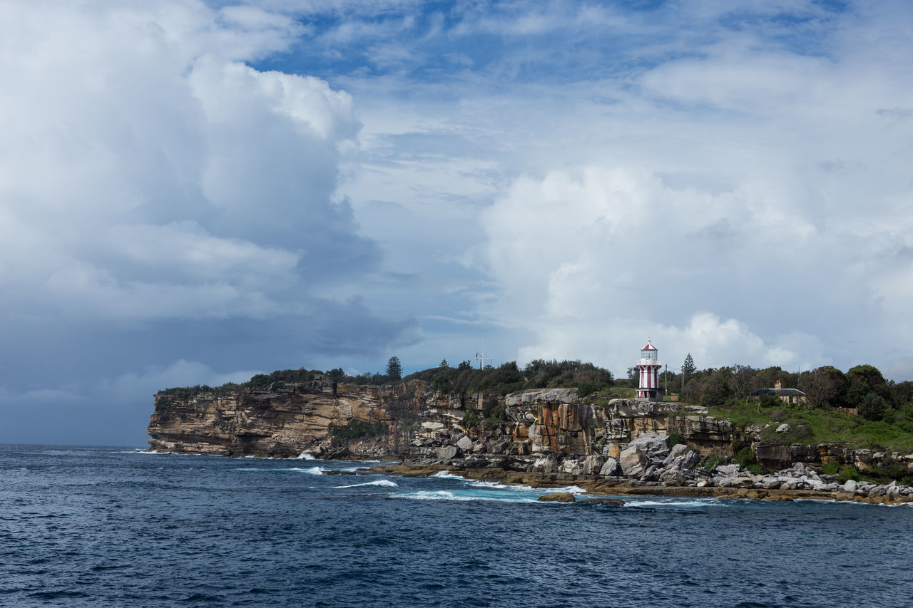lighthouse, sea, cloud - sky, sky, architecture, building exterior, built structure, water, day, nature, guidance, outdoors, tranquility, no people, scenics, beauty in nature