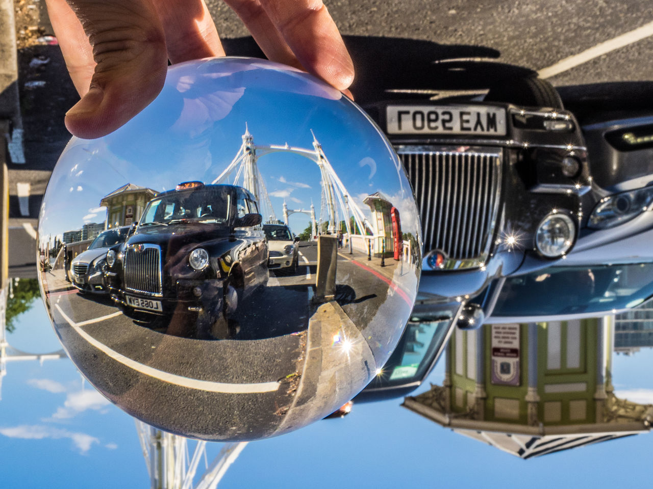 Albert Bridge Architecture Battersea Black Cab Bridge Britain Car Chelsea Close-up Crystal Ball Day England Human Hand Landscape London London Cab Mode Of Transport No People One Person Outdoors Real People Taxi Transportation United Kingdom The Street Photographer - 2017 EyeEm Awards