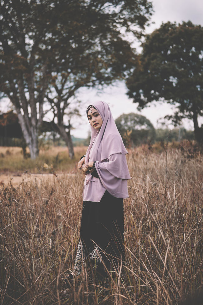 Grass Person Young Adult Tree Side View Field Full Length Standing Focus On Foreground Young Women Rural Scene Nature Day Tranquility Tranquil Scene Outdoors Alone People People And Places Mood Girl Portrait Fashion Sonyimages Hijab