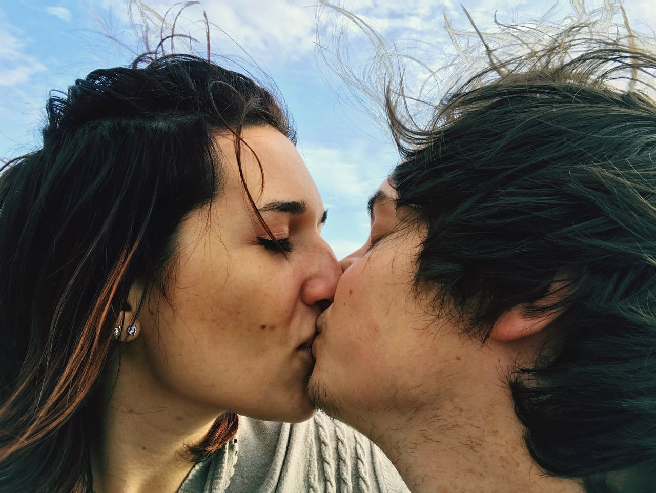 EyeEmNewHere Love Kissing Wind Togetherness Hairflying Two People Couple