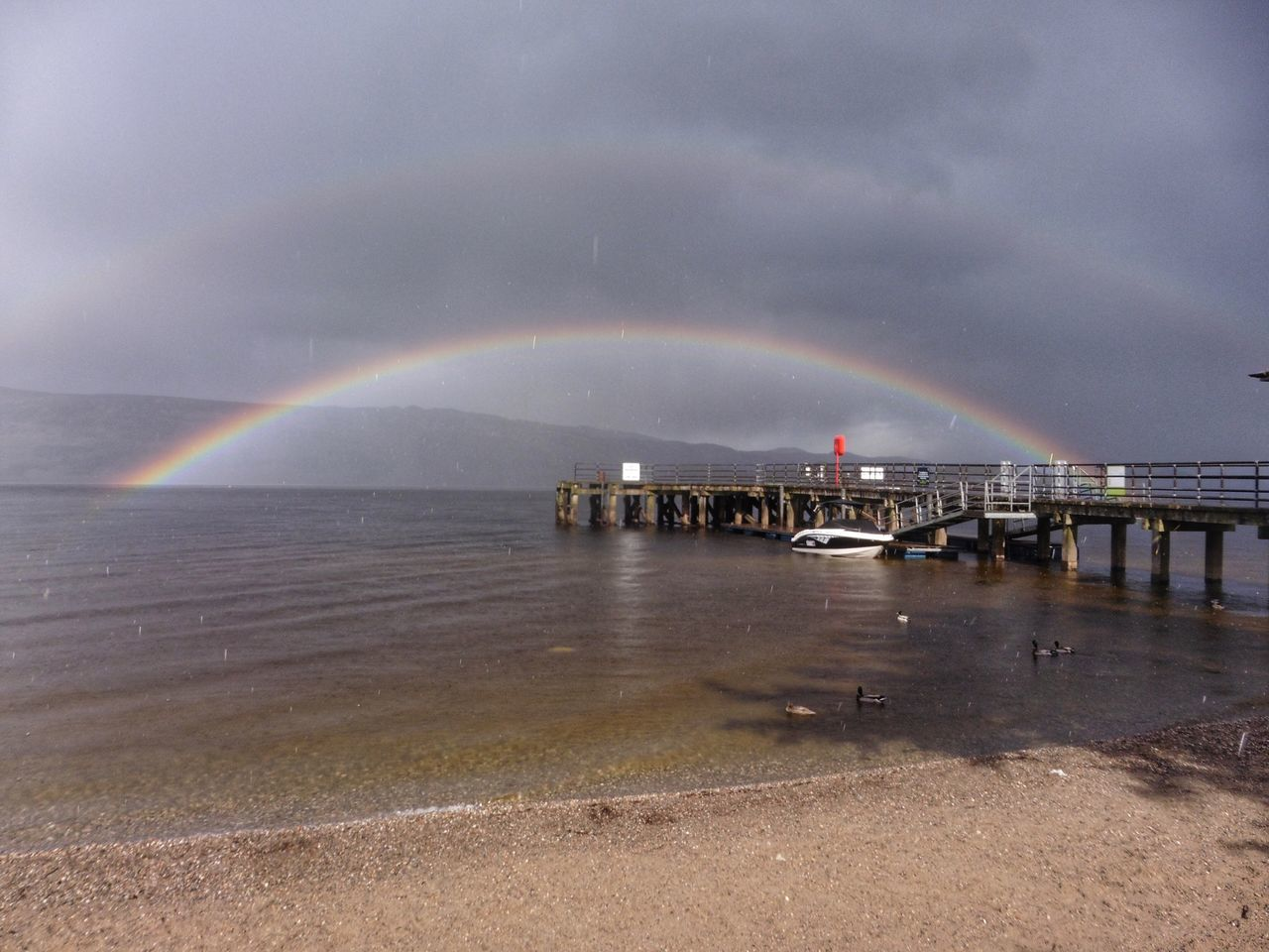 Rainbow Scenics Cloud - Sky Weather Sky Beauty In Nature Outdoors Double Rainbow Nature Sea Water Beach No People Storm Cloud Storm Architecture Day Natural Phenomenon Thunderstorm Scotland LochLomond Luss Travel Destinations Travel Photography Take It Easy