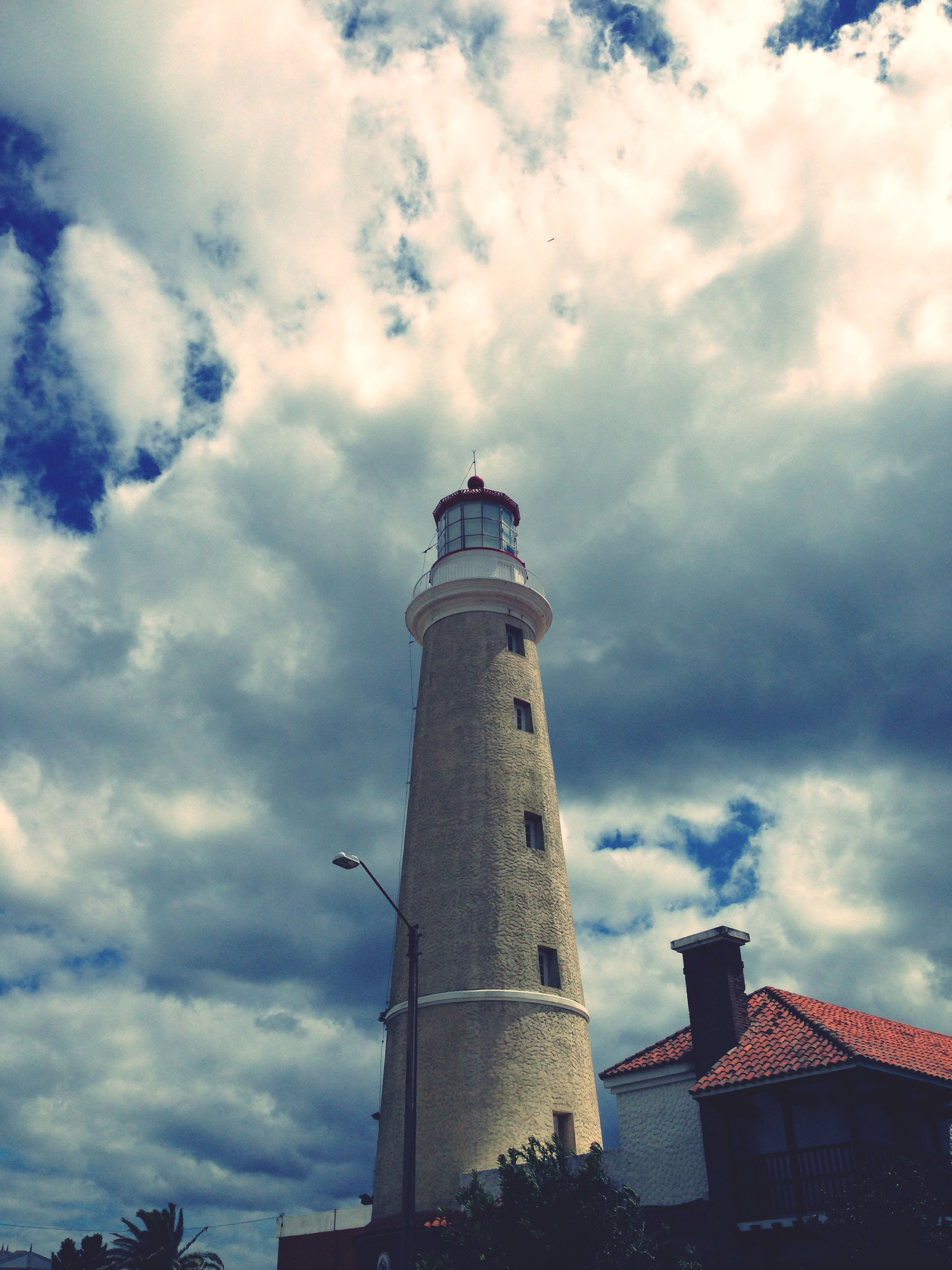 cloud - sky, sky, architecture, tower, low angle view, built structure, building exterior, lighthouse, history, travel destinations, city, no people, day, outdoors, nature