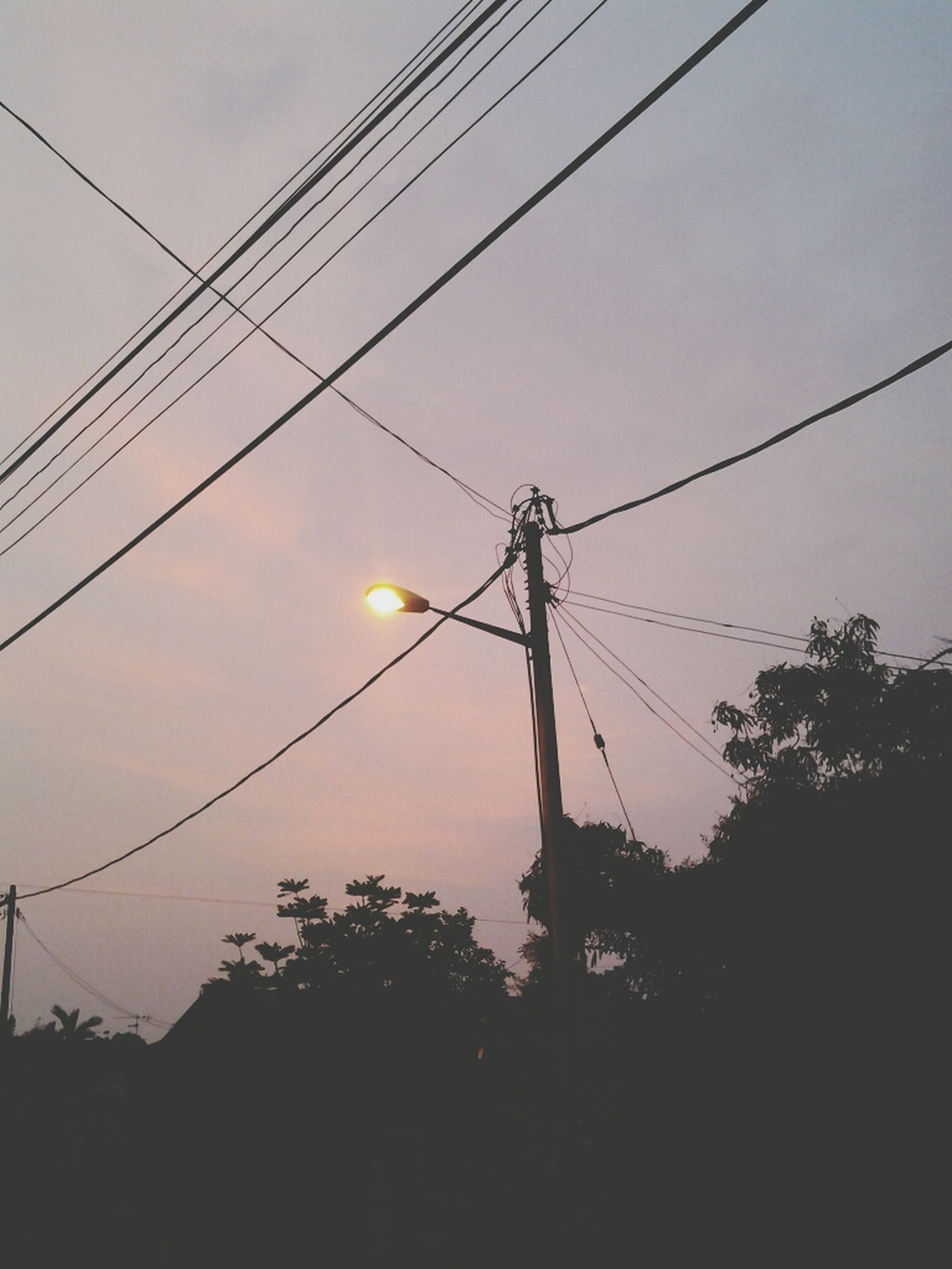 power line, power supply, electricity pylon, electricity, cable, fuel and power generation, low angle view, connection, technology, sky, silhouette, power cable, sunset, built structure, telephone pole, telephone line, outdoors, dusk, no people, complexity