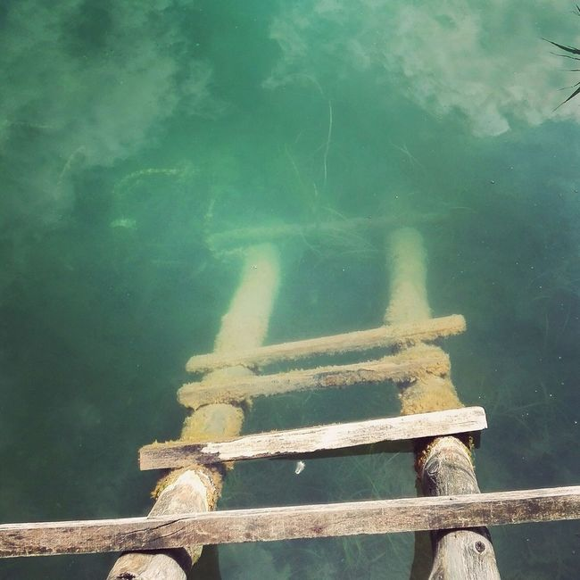 This photo was taken at beautiful mountain lake in Bosnia. I was really impressed with that peaceful scene, old wooden dock ladders just dives into cold clear water with amazing sky reflection above. Hope you'll love it ... Mountains And Sky Mountain Lake Taking Photos Lakeside Lakeshore Lakescape Ladder To Nowhere Ladder In Sky Laddertoheaven Wooden Ladder Sky And Clouds Sky Porn Sky Reflected In Water Sky Reflection Sky Photography Lake Photography Peace And Quiet Peacful Day Mountain Life Enjoying Life Outdoor Photography Clear Water Lake Outdoor Beauty Calm Water Green Water First Eyeem Photo