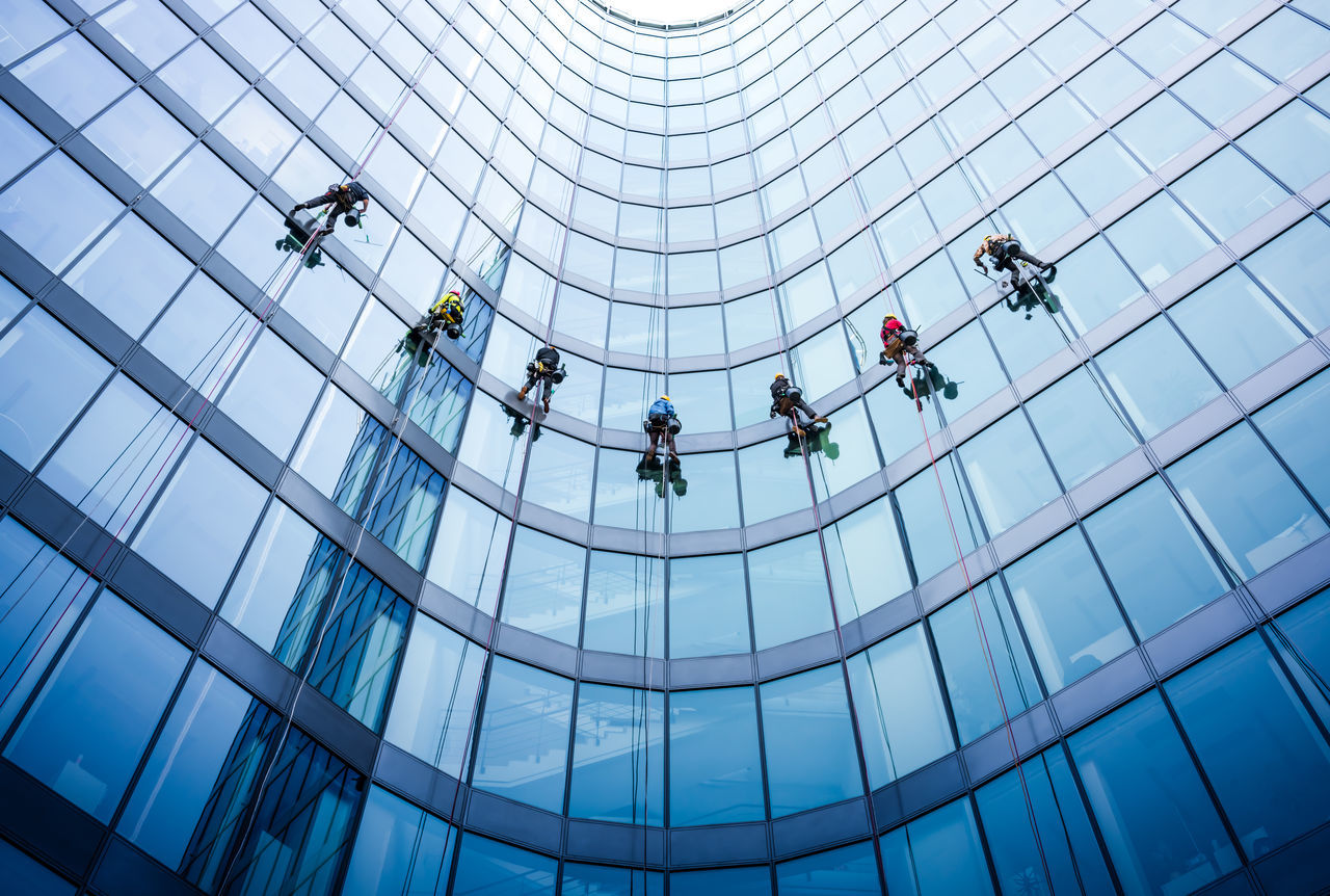 Hanging from the sky. Architecture Blue Blue Wave Building Exterior Built Structure Business City Day Futuristic Modern Office Building Exterior Outdoors People Skyscraper Teamwork Window Washer Working