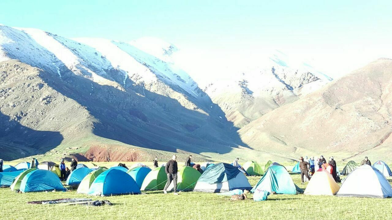 tent, day, mountain, nature, camping, real people, large group of people, outdoors, beauty in nature, sunlight, cold temperature, mountain range, shelter, blue, women, landscape, scenics, sitting, sky, people