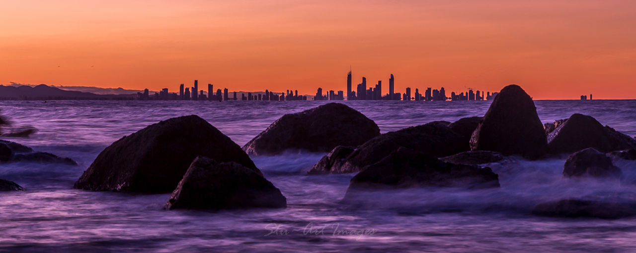 Sunset on Rainbow Bay looking at Surfers Paradise across the waters Being A Beach Bum Sunshine Swimming Surfing Gold Coast Australia Clouds And Sky EyeEm Best Shots - Sunsets + Sunrise Snapper Rocks