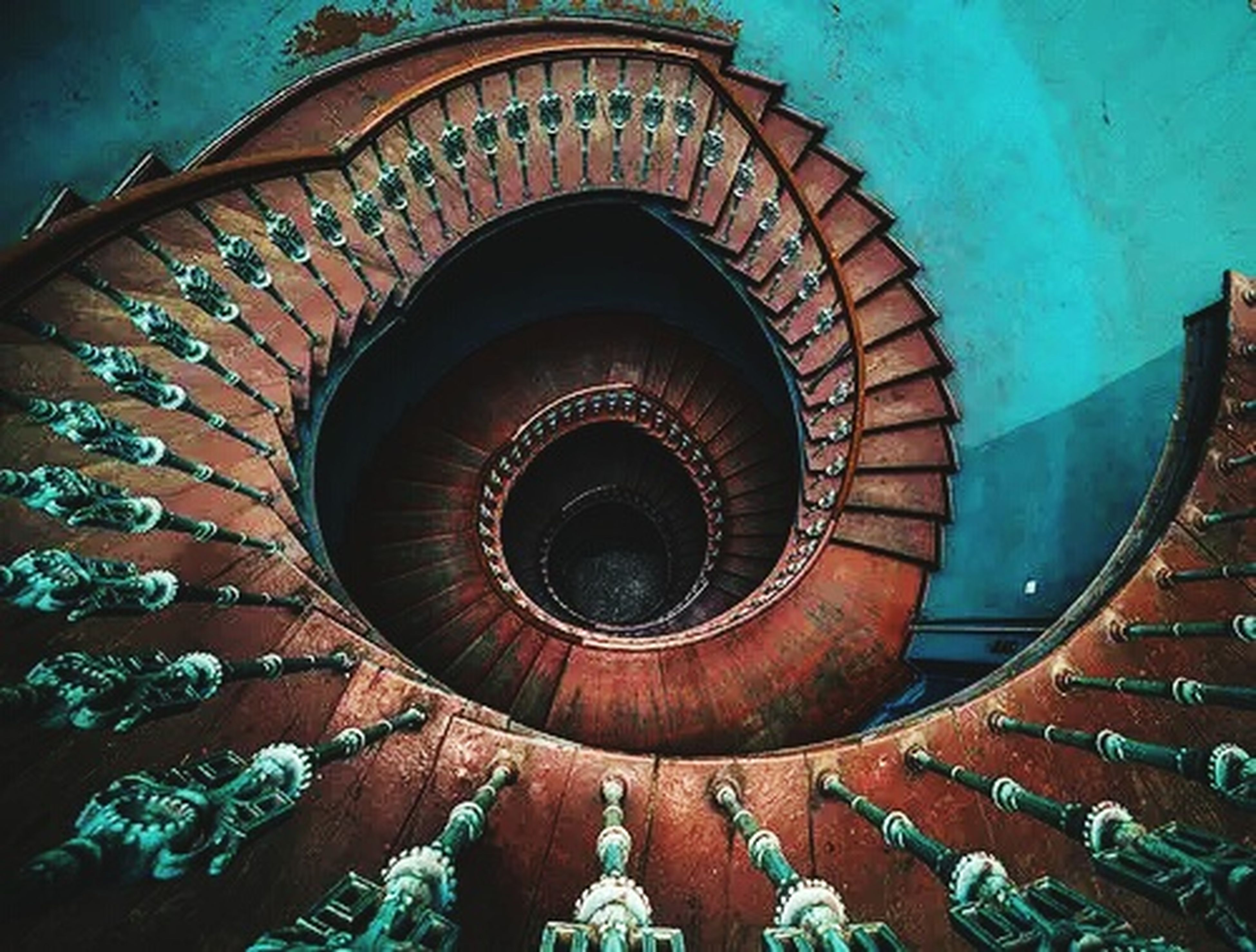 steps, steps and staircases, staircase, built structure, architecture, spiral, spiral staircase, pattern, railing, design, building exterior, indoors, low angle view, circle, stairs, high angle view, wall - building feature, no people, day, arch