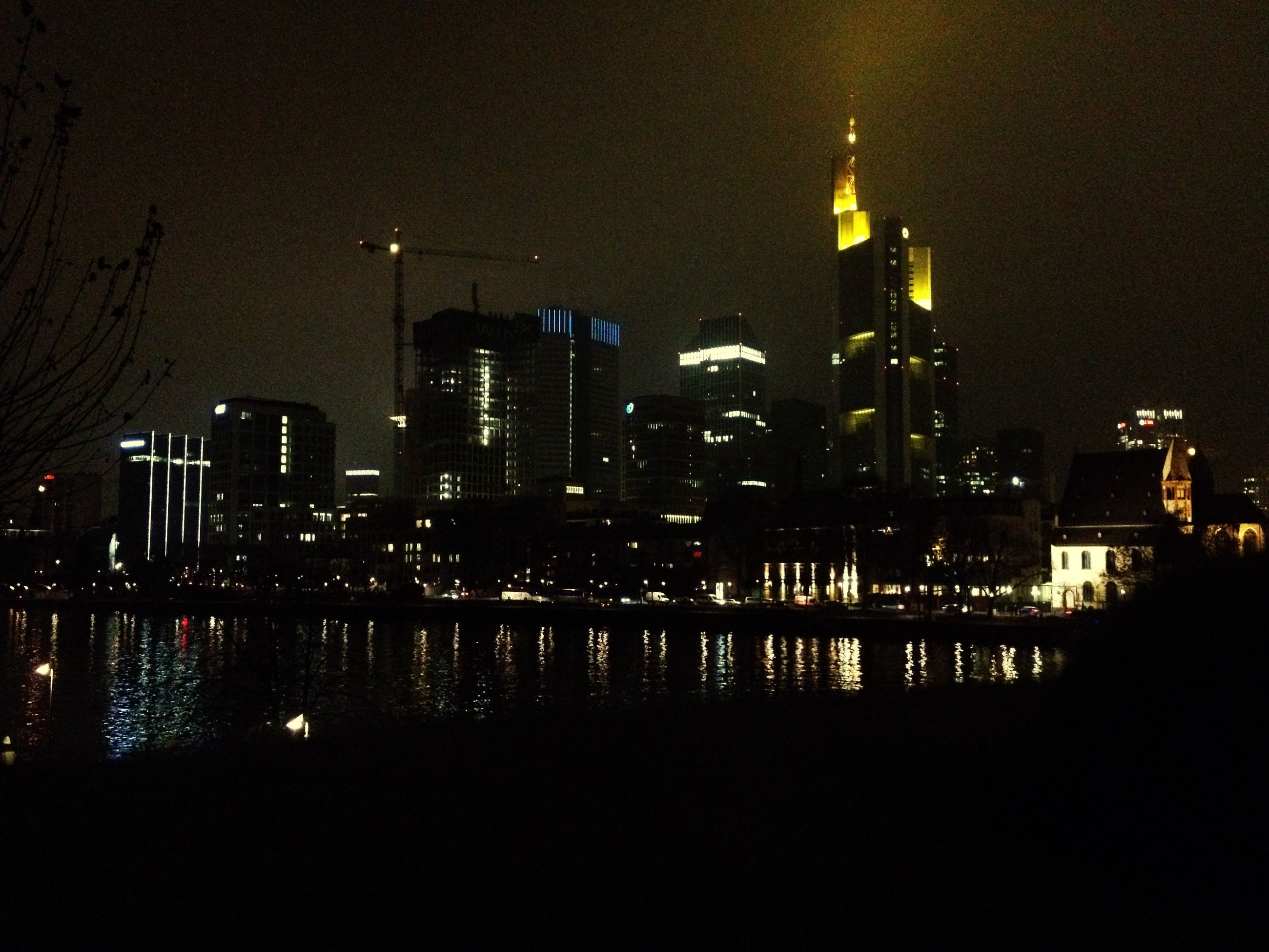 night, illuminated, city, architecture, building exterior, travel destinations, no people, built structure, tower, skyscraper, urban skyline, outdoors, sky, modern, cityscape, water