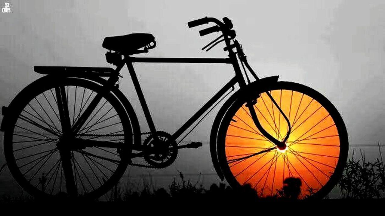 silhouette, bicycle, sunset, dusk, illuminated, transportation, mode of transport, wheel, no people, outdoors, night, nature, sky