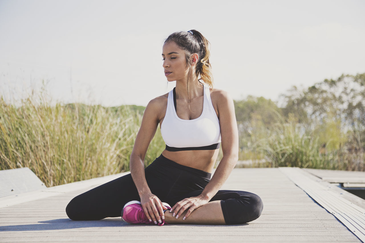 Adult Adults Only Beautiful Woman Day Exercise Mat Exercising Full Length Healthy Lifestyle Lifestyles One Person One Woman Only Only Women Outdoors People Relaxation Exercise Self Improvement Sitting Sport Sports Clothing Sports Training Wellbeing Yoga Young Adult