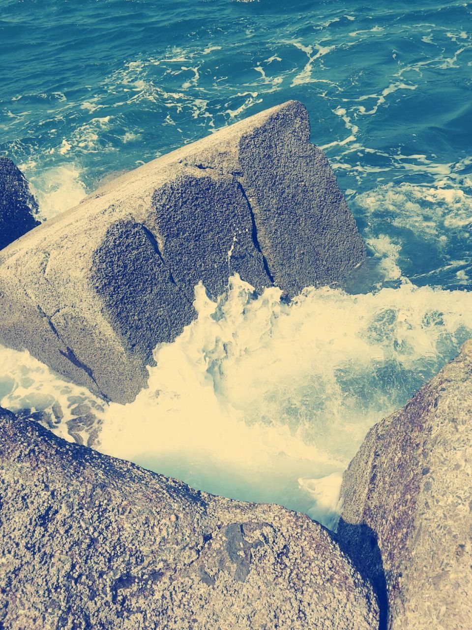 water, nature, rock - object, beauty in nature, tranquility, outdoors, day, no people, high angle view, sea, scenics, tranquil scene, physical geography, beach, mountain