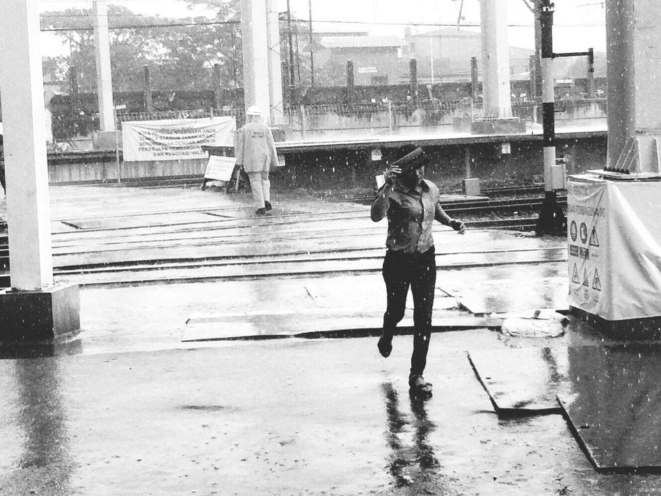 Running from the rain. Rain Streetphotography Blackandwhite Mobilephotography Train Station Jakarta