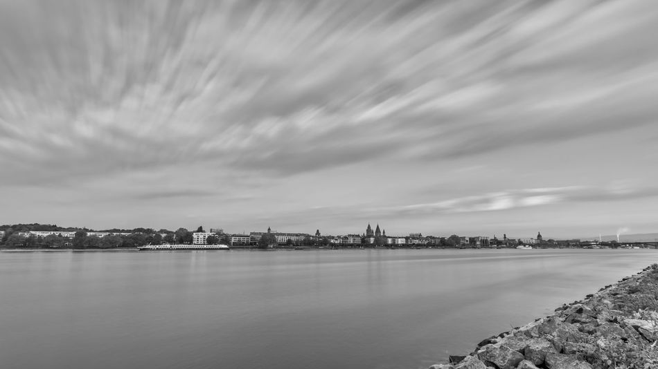 Architecture Beauty In Nature Black And White Building Exterior Built Structure City Cityscape Cloud - Sky Day Long Exposure Nature No People Outdoors River Scenics Sky Travel Destinations Water Waterfront