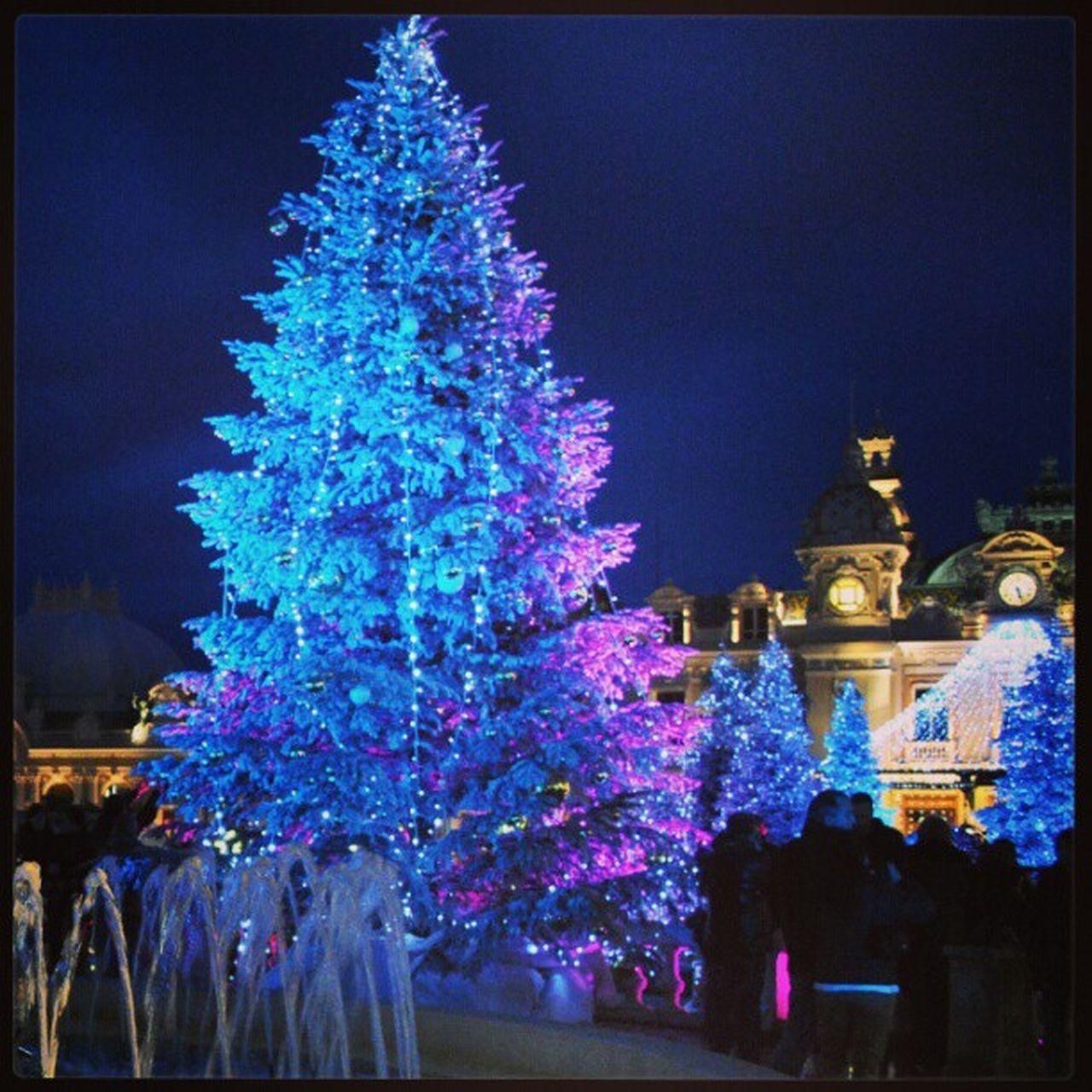 night, illuminated, celebration, christmas, christmas tree, building exterior, architecture, tree, christmas lights, no people, religion, outdoors, built structure, statue, christmas decoration, city, sky