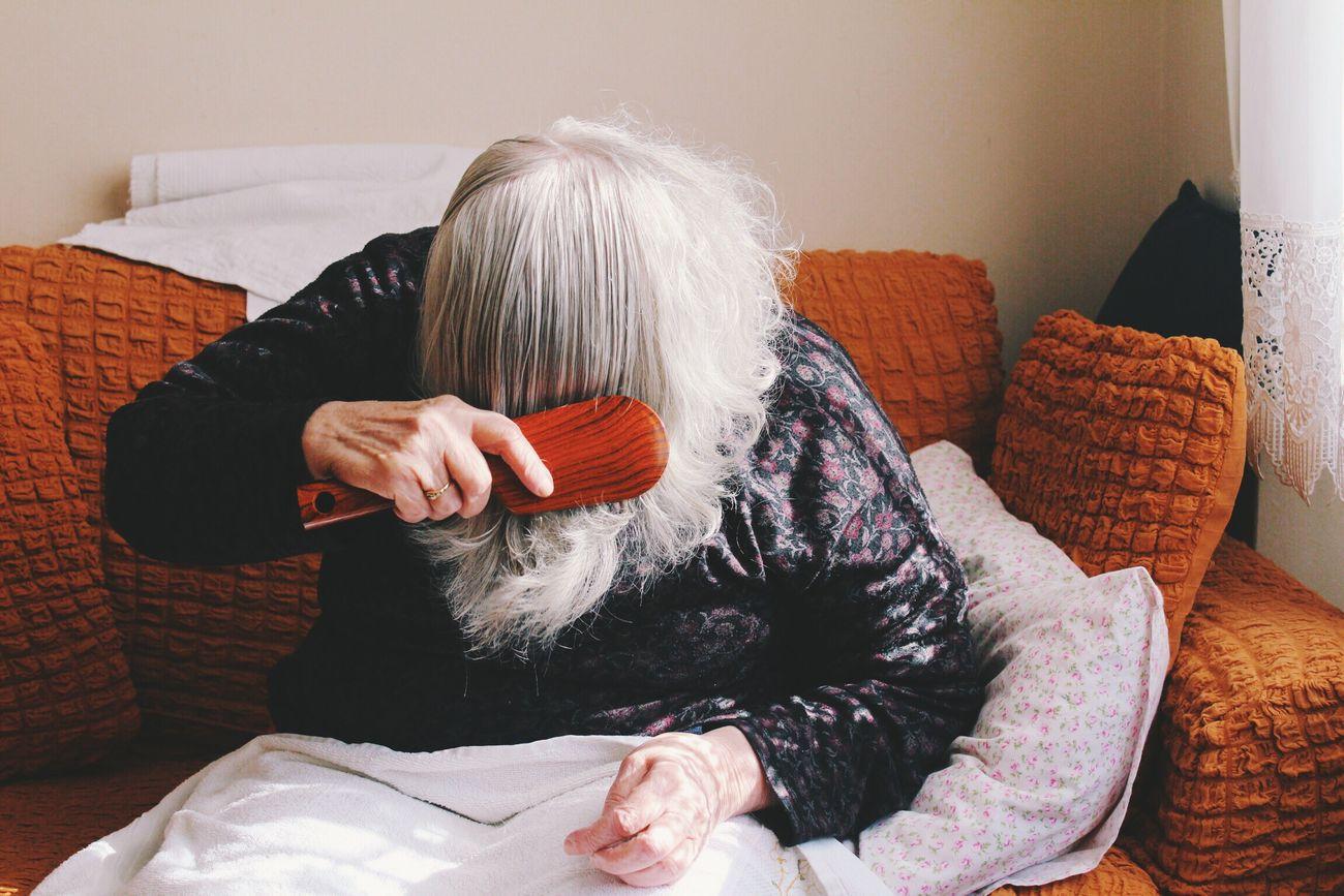 She was brushing her hair in a lovely lighting Lieblingsteil Hair Brush Hairbrush Grandma Home Cozy The Portraitist - 2017 EyeEm Awards