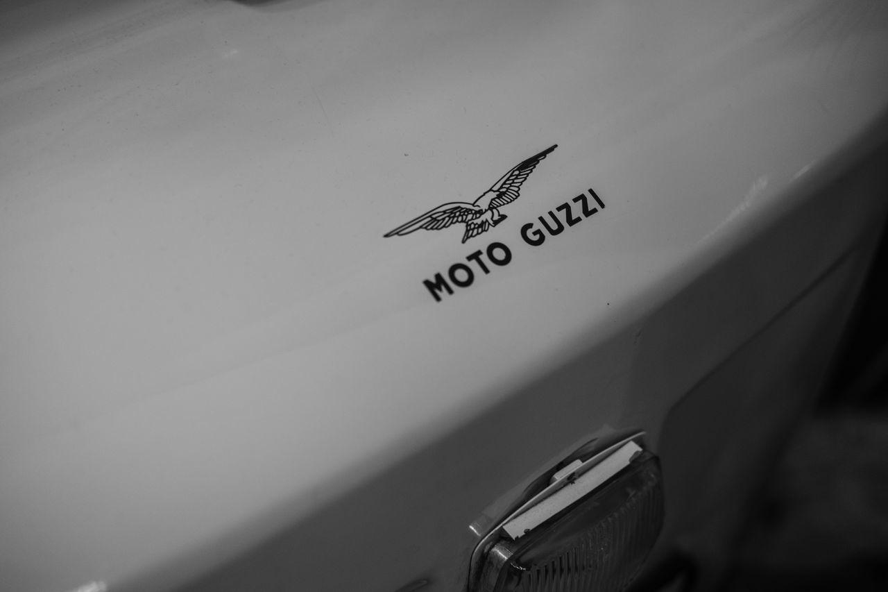 moto guzzi Blackandwhite Car Close-up Communication Day Indoors  Italian Monochrome Motoguzzi No People Paper Text Vehicle