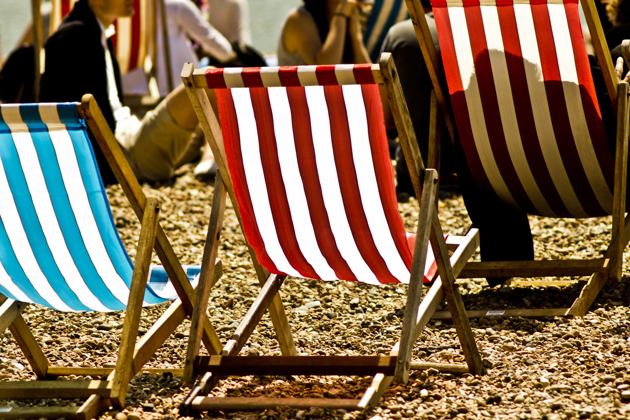 Old one from a trip to Brighton early days of my camera back then Beach Chair Day Deck Chair Deckchairs Holiday Hot Lieblingsteil Low Section No People Outdoors Relax Striped Sunbathing Sunchair Miles Away The City Light The Street Photographer - 2017 EyeEm Awards