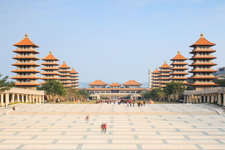 Kaohsiung, Taiwan - December 15, 2014: Sunset at Fo Guang Shan buddist temple of Kaohsiung, Taiwan with many tourists walking by. Architecture ASIA Asian  Asian Culture Buddha Buddha Statue Building Exterior Built Structure City Clear Sky Day Façade Famous Place Fo Guang Shan Kaohsiung Lifestyles Outdoors Religion Sky Summer Taiwan Tourism Tourist Tradition Travel Destinations