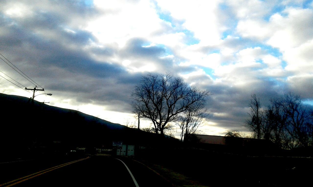 Bare Tree Tree Cloud - Sky Road No People Dramatic Sky Sky Outdoors Nature Day Surrealism The Way Forward Roads Drivebyphotography Nature Beauty In Nature Dramatic Edit Moods Art Photography