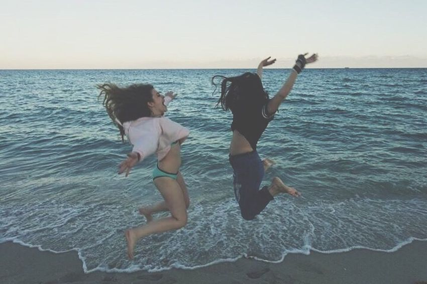 Full Length Togetherness Fun Sea Motion Vitality Carefree Bonding Two People Happiness Mid-air Jumping Mid Adult Enjoyment Vacations Females Girls Family Sister Sisters ❤ Miami Miami Beach