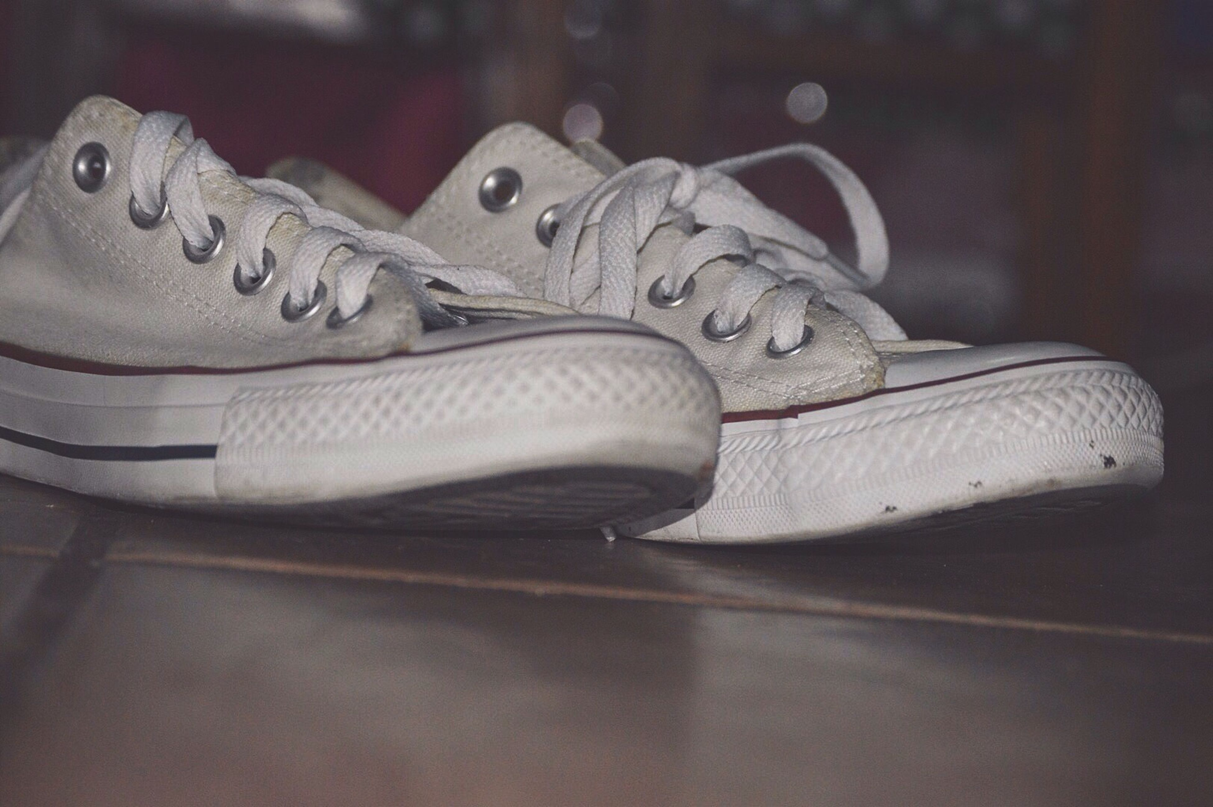 indoors, close-up, art and craft, focus on foreground, still life, art, no people, animal representation, part of, creativity, white color, cropped, high angle view, shoe, statue, table, selective focus, day, footwear, human representation