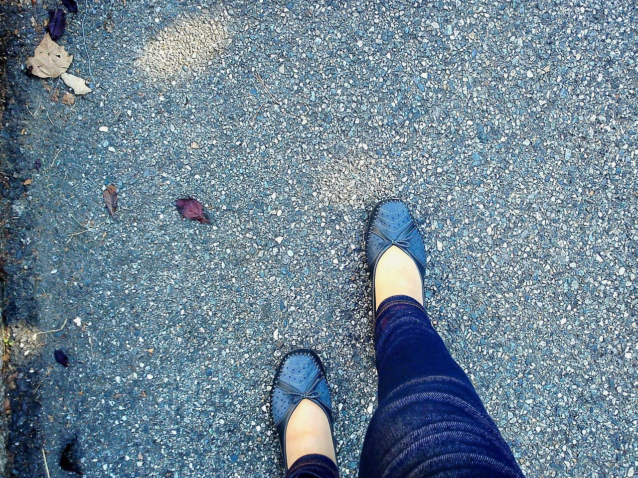 low section, human leg, shoe, personal perspective, human body part, real people, one person, standing, human foot, high angle view, outdoors, day, directly above, lifestyles, women, men, nature, close-up, people, adult