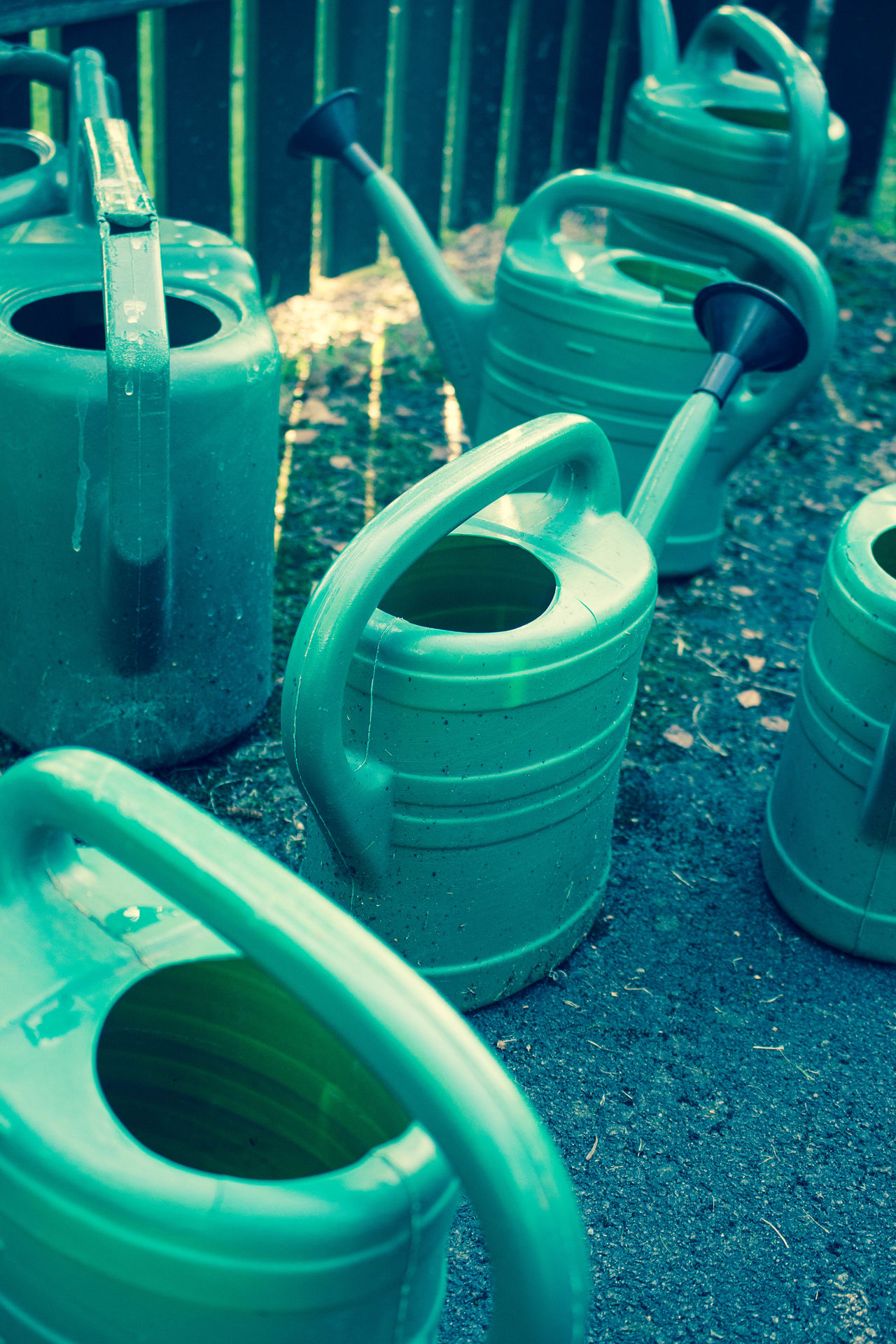 A green-tinted world of watering cans. Bucket Buckets Close-up Day Green Green Color No People Outdoors Water Bucket Water Jug Watering Can