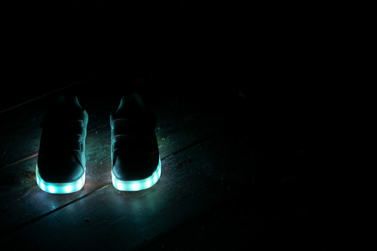 copy space, night, low section, pair, shoe, human leg, one person, indoors, illuminated, close-up