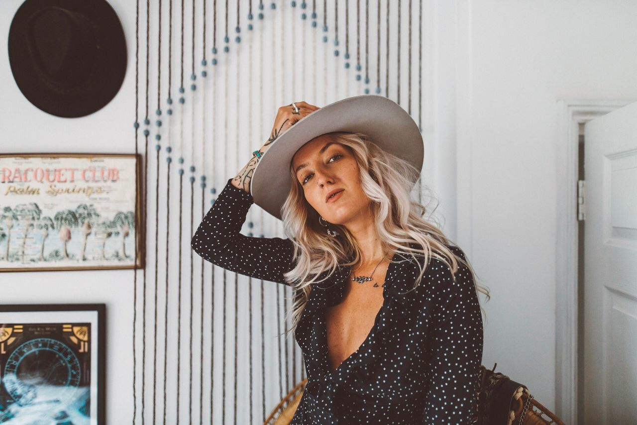 Eliza Hat One Person Young Adult Indoors  Young Women Real People Leisure Activity Front View Beautiful Woman Fashion Portrait Lifestyles Sun Hat Looking At Camera Smiling Blond Hair Day One Young Woman Only Adult People
