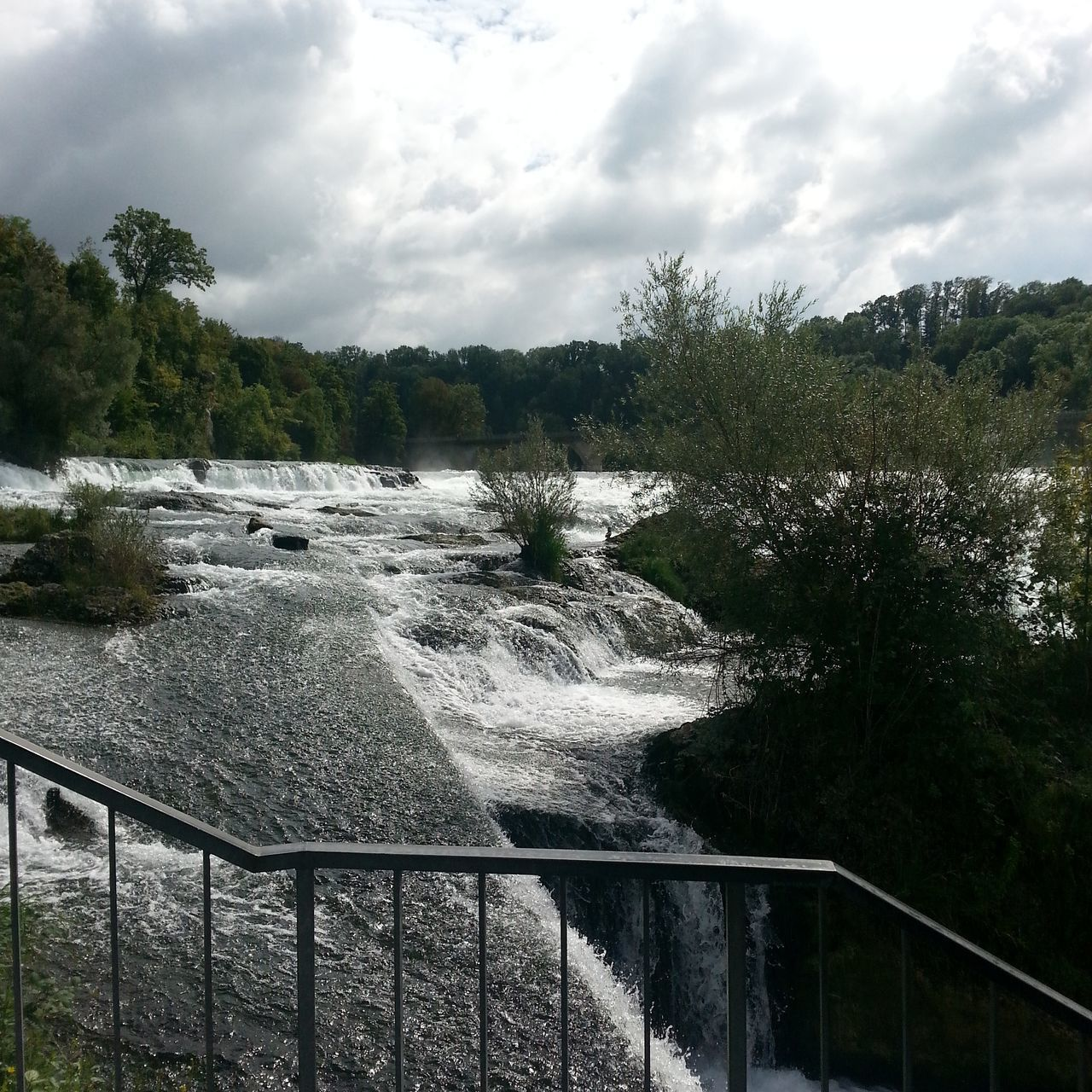 water, tree, cloud - sky, nature, sky, no people, day, beauty in nature, scenics, railing, river, outdoors, motion, tranquility, tranquil scene, waterfall