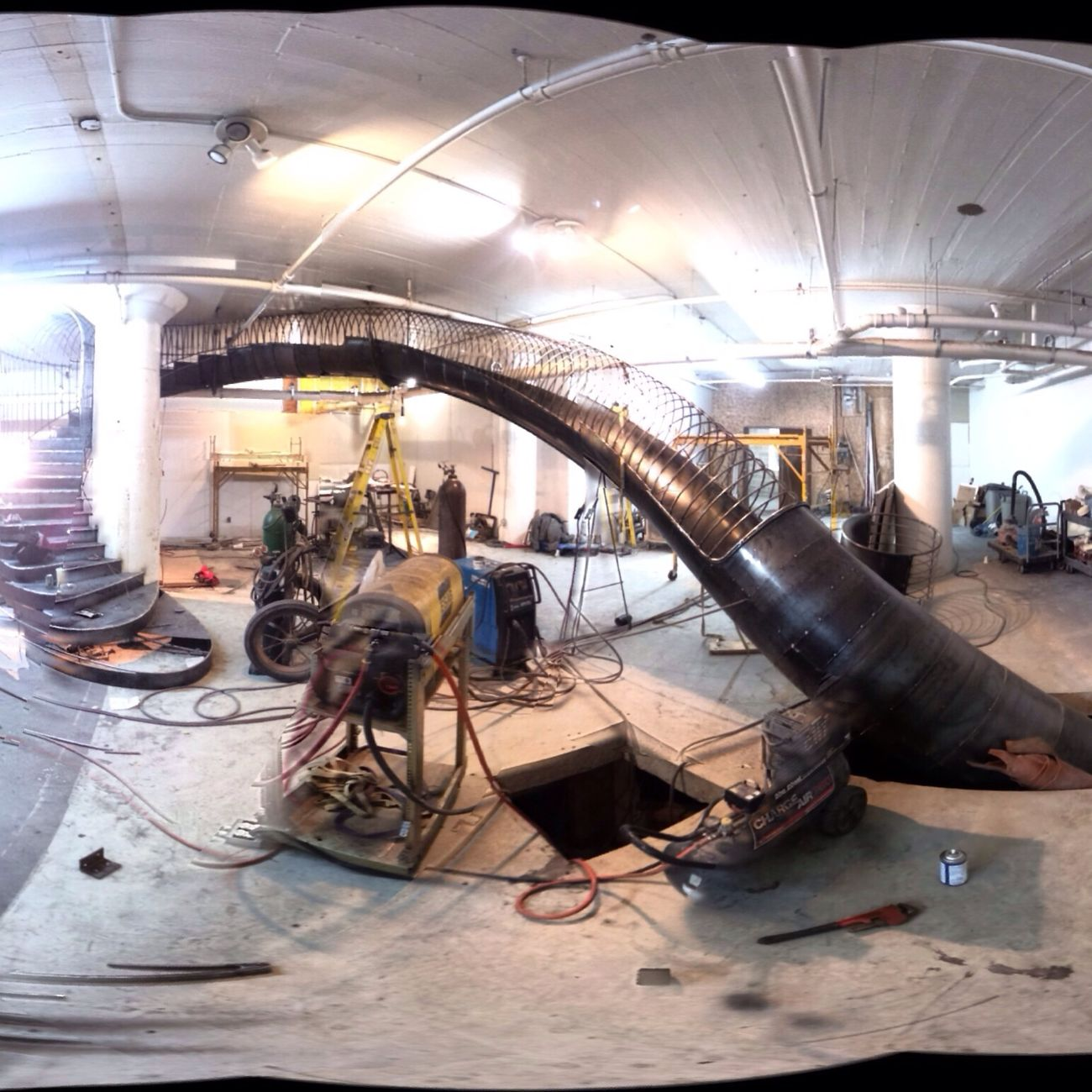 partial panorama of a slide going in on 3rd and 4th floor. Slide Citymuseum